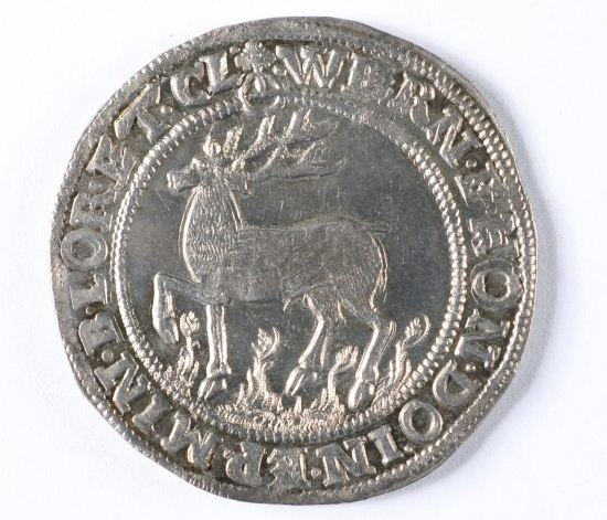 A shiny silver-colored coin. There is a stag in the center within a circle. Text surrounds the edges.