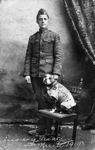 Black and white photo of man with dog