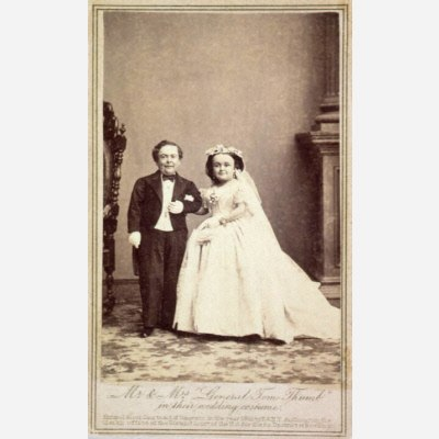 The couple Mr. and Mrs. Tom Thumb in their wedding dress standing arm in arm