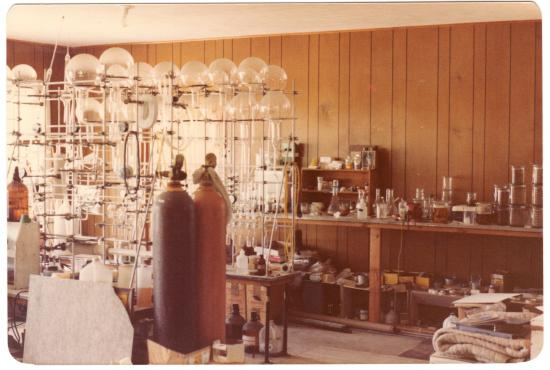 Crowded laboratory filled with tubes and tanks