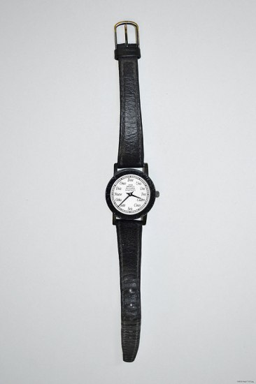 A black wristwatch with a white clock face