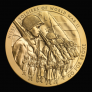 """The medal's obverse (heads side) design features Nisei (second-generation Americans of Japanese ancestry) Soldiers from both the European and Pacific theaters. The 442nd RCT color guard is depicted in the lower field of the medal. The inscription """"Go For Broke"""" is the motto of the 442nd RCT, and was eventually used to describe the work of all three units."""