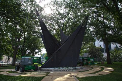 Gwenfritz sculpture under the trees