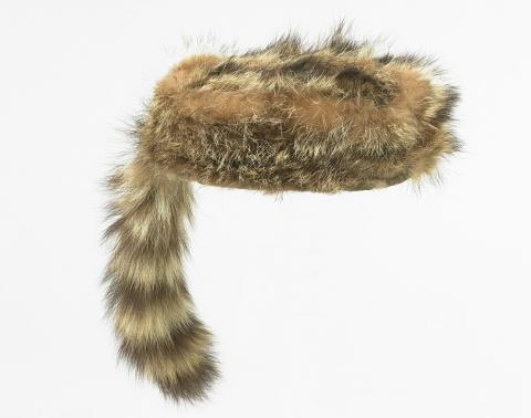 "Child's ""Davy Crockett"" hat with brown fur and tail at back"