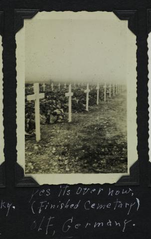 Row of graves with white crosses on them