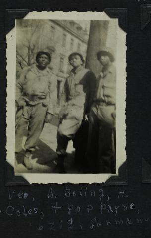 Three men in military uniform standing together casually