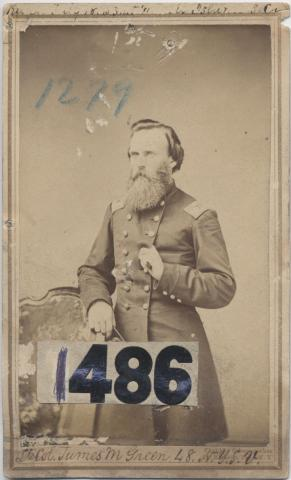 Photograph of a soldier in a uniform coat with a long beard