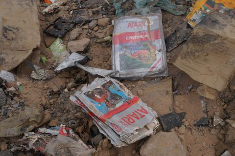 Crumpled E.T. games in the dirt and rocks
