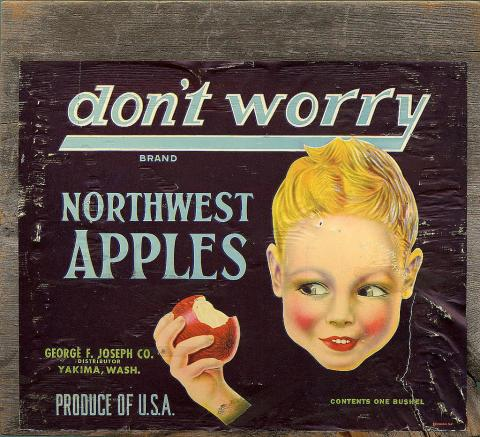Apple crate label featuring a smiling child with an apple