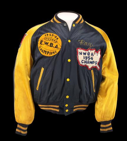 "Blue jacket with yellow sleeves, buttons, zippers, and details. Patch on left says ""EWBA Champions."""