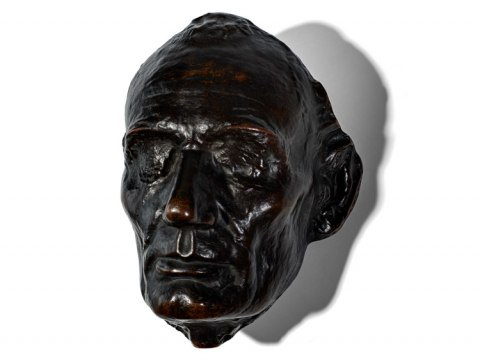 Bronze Abraham Lincoln life mask on white background