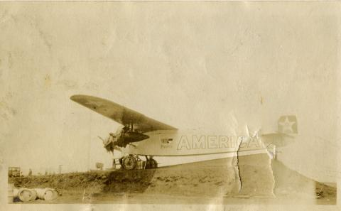"Airplane with the word 'AMERICA"" on the side and a star on the tail"