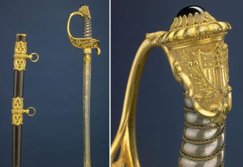 Two images of a gold presentation sword