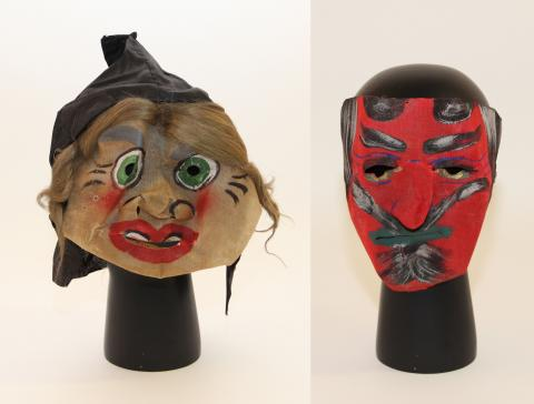 Two masks with ghoulish faces and big eyes