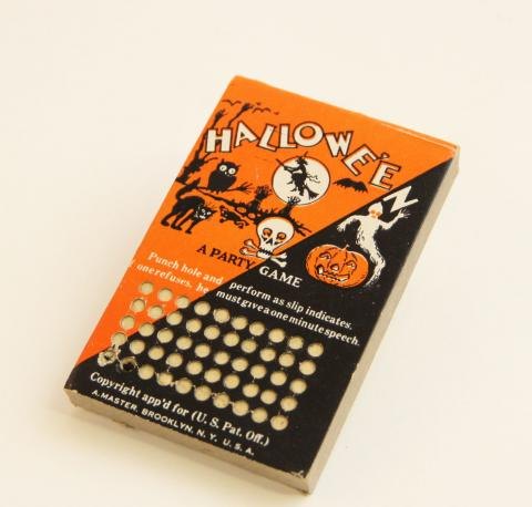 Cardboard and metal punch game decorated with spooky cartoon figures