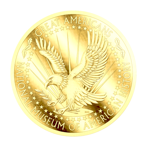 A golden coin with an eagle soaring on the front