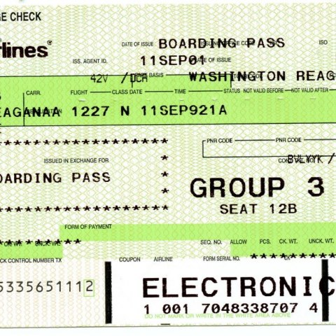 Photograph of paper airline boarding pass from September 11, 2001