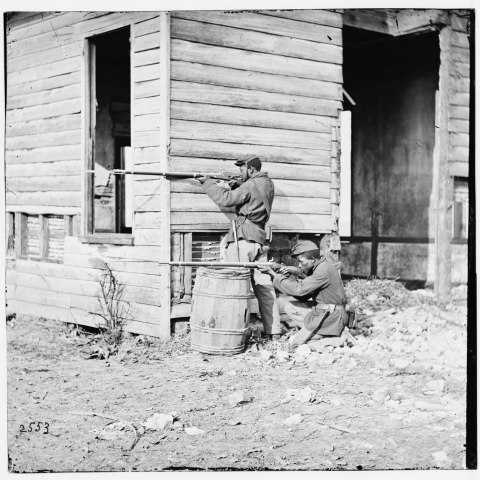 Men Shooting around a barn, U.S. Colored Troops, Virginia, 1864 (Library of Congress)