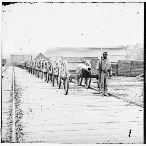 Soldier with cannon, City Point, Virginia, about 1865 (Library of Congress)