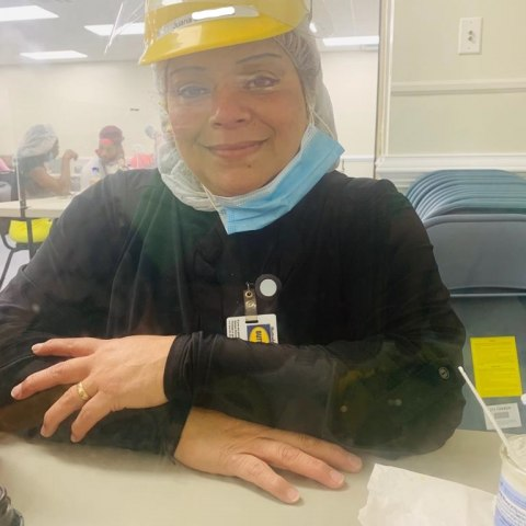 Poultry worker with faceshield