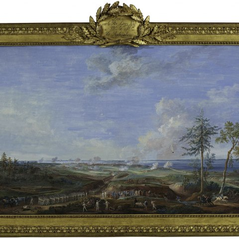 A painting of a battle under a blue sky encased in an ornate gold frame