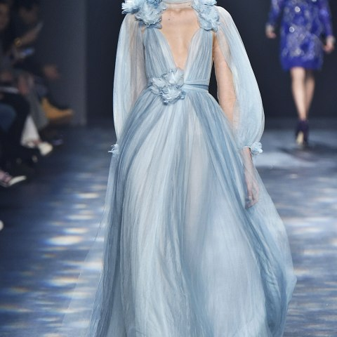 A model wears a filmy periwinkle gown on a runway