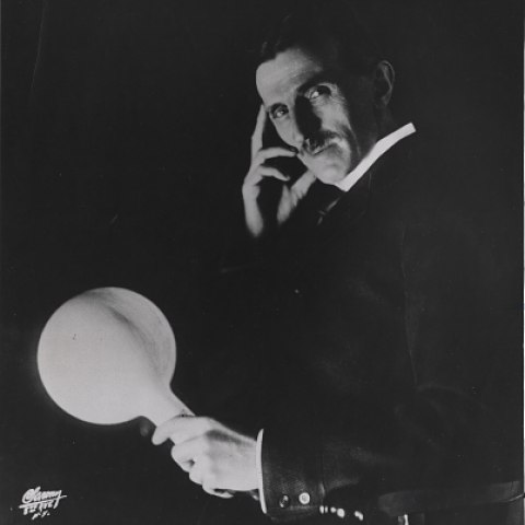 Tesla with wireless light, about 1919