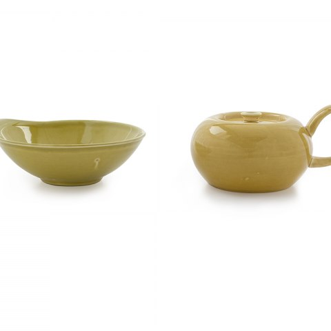 A yellow bowl and a matching object with a curved handle