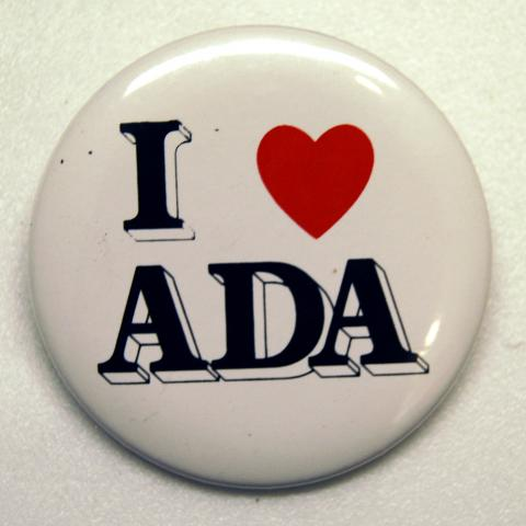 """Circular white button with bold, capitalized text saying """"I [heart symbol] ADA"""""""