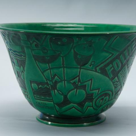 Green tall bowl with jazzy designs in black