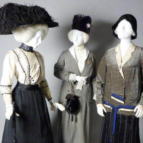 "3 mannequins with ""new woman"" clothing"