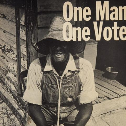 """One Man, One Vote"" poster with photo of man in hat and overalls, black and white"