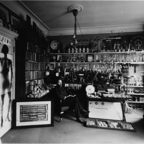 William Hammer sitting in his lab. This black and white photoprint is part of the William J. Hammer Collection, Archives Center, National Museum of American History, Smithsonian Institution.