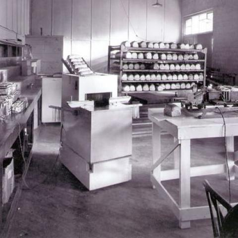 Empty bakery, black and white photo, with bread and bread slicing machines