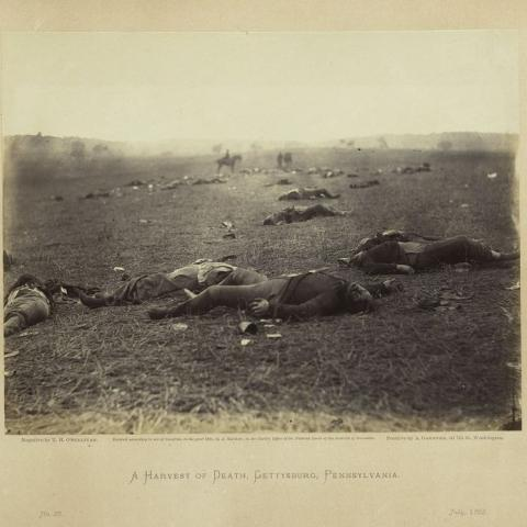 """""""A Harvest of Death, Gettysburg, Pennsylvania, July 1863"""" is plate number 36 in Gardner's Sketchbook of the War. Timothy O'Sullivan made the photograph with a wet plate collodion negative."""