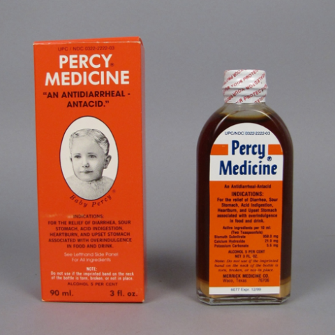 """Percy Medicine, 1996-1999. """"For the relief of diarrhea, sour stomach, acid indigestion, heartburn, and upset stomach associated with overindulgence of food and drink."""" Orange packaging with a child's face."""