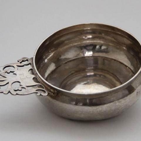 silver bowl with fancy handle