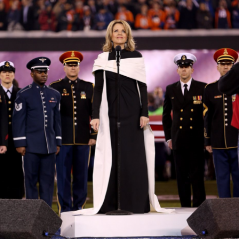 At the Super Bowl, Renee Fleming prepares to sing in a black and white dress