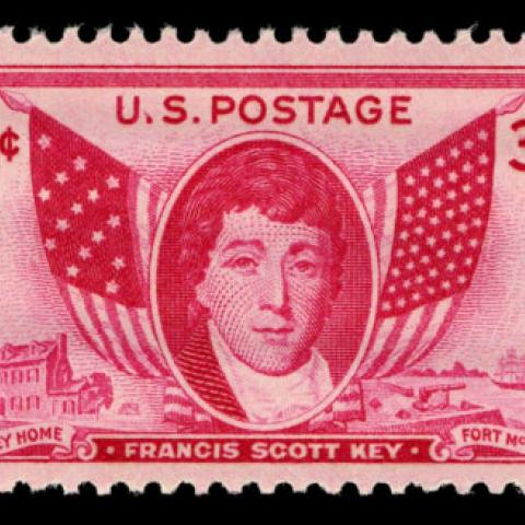 US postage stamp including two flags and the face of Francis Scott Key