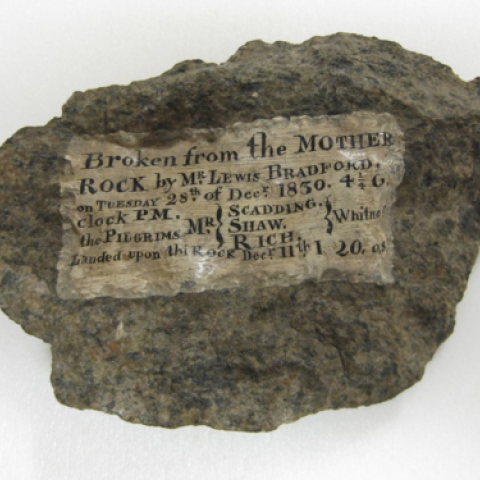 "Rock fragment labelled ""Broken from the Mother Rock..."""