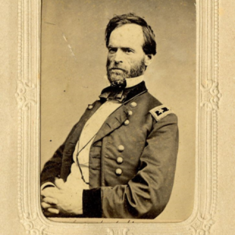 Civil War General Sherman in coat with buttons, seated, grim expression
