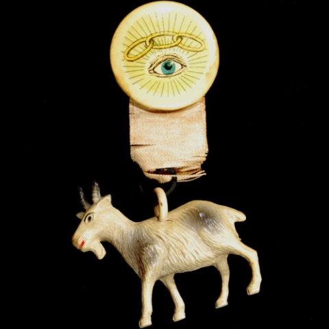 Celluloid button featuring the image of a three-link chain, symbol of the Independent Order of Odd Fellows