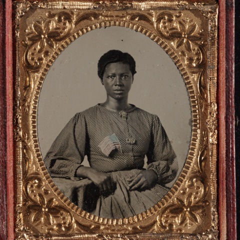 Ambrotype of the washerwoman for the Union Army, who has an American flag on her outfit