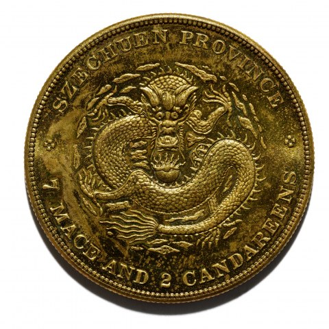"Gold coin featuring a fierce image of a dragon. Its eyes make eye contact with the viewer. Its body is snake-like. It looks angry. Text: ""Szechuen Province."""