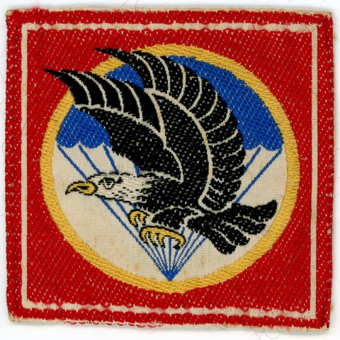 Shoulder patch with image of an eagle in flight and a parachute in the background