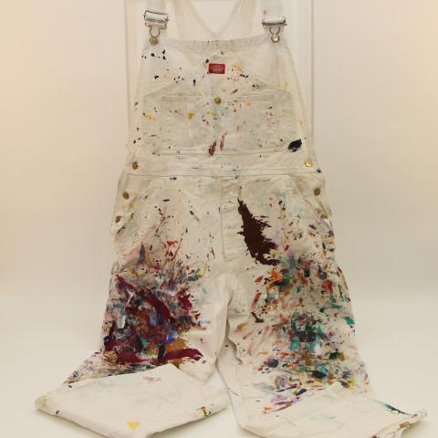 Photo of white overalls splattered with paint