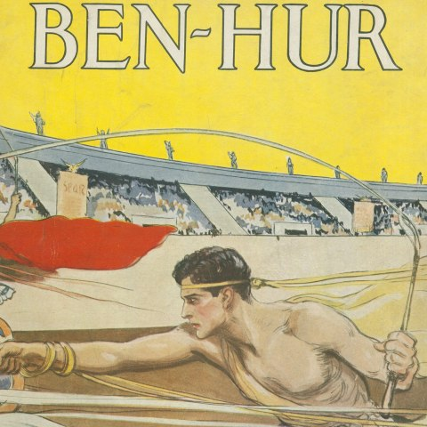 An illustration of a man in a chariot riding in a stadium under a yellow sky.