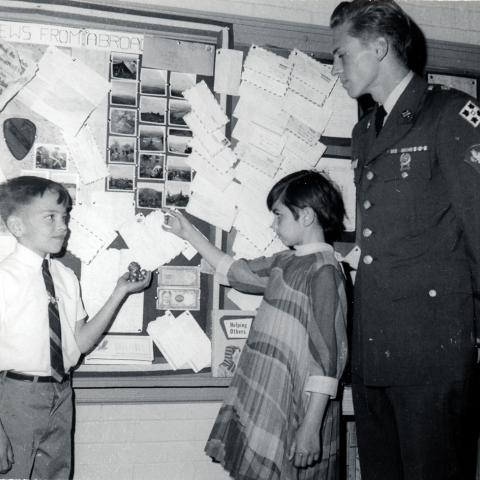 Students show off their letters on a bulletin board