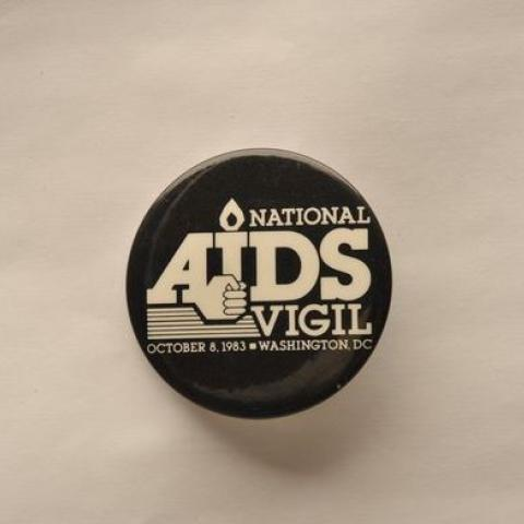 """Button with """"National AIDS Vigil"""" text in white on black background"""