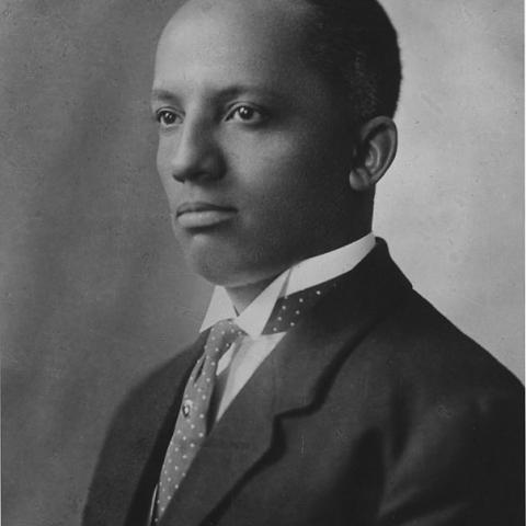 Portrait of a young man in a suit, necktie, and wing-collar